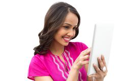 Stock Photo of Smiling woman using a digital tablet
