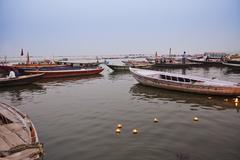 Boats at Rajendra Prasad Ghat, Ganges River, Varanasi, Uttar Pradesh, India - stock photo