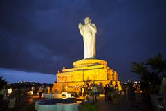 Tourists near a Statue of Buddha, Hussain Sagar, Hyderabad, Andhra Pradesh, Stock Photos