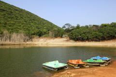 Boats in a lake, Kambala Konda Eco Tourism Park (Majjisrinath), Visakhapatnam, Stock Photos