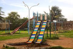 Slides in a park, Visakhapatnam, Andhra Pradesh, India - stock photo