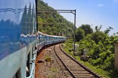 Train moving on a railroad track, Visakhapatnam, Andhra Pradesh, India - stock photo