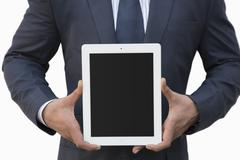 Stock Photo of Businessman holding a digital tablet