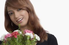 Stock Photo of Portrait of a woman holding bouquet of Carnation flowers