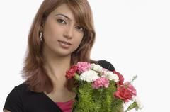 Portrait of a woman holding bouquet of Carnation flowers Stock Photos