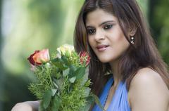 Displeased woman holding bouquet of Rose flowers Stock Photos