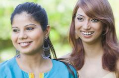 Close-up of two women smiling - stock photo
