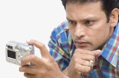 Man taking picture of himself with a digital camera Stock Photos
