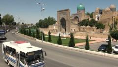 Traffic drives past 'Shah i Zinda' mausoleum in Samarkand Stock Footage