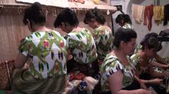 Weaving carpets in Uzbekistan, women in colorful dresses Stock Footage