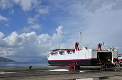 arrival from the ferry boat - stock photo
