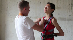 she communicates with the instructor during the equipment before you leap - stock footage