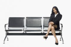 Businesswoman sitting on an armchair - stock photo