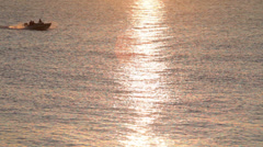 Motorboat on the sea at dawn Stock Footage