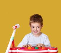 Boy play music on keyboard Stock Photos