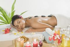 Young woman getting lastone therapy - stock photo