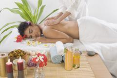 Young woman getting back massage from a massage therapist Stock Photos