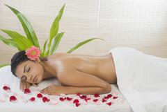 Young woman getting spa treatment - stock photo