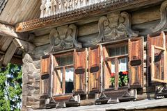 facade of traditional russian old wooden house - stock photo