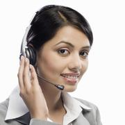 Female customer care executive wearing a headset against a white background Stock Photos