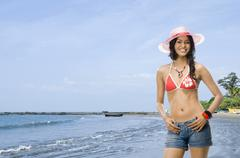 Portrait of a female fashion model posing on the beach Stock Photos