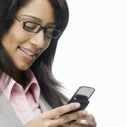 Businesswoman text messaging - stock photo