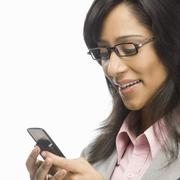 Stock Photo of Businesswoman text messaging