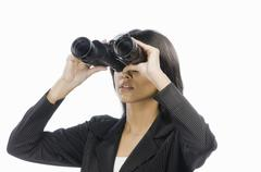 Businesswoman looking through binoculars Stock Photos