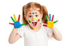 Three year old gilr with brightly painted hands Stock Photos