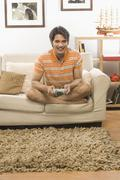 Young man playing video game in the living room - stock photo