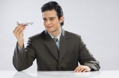Businessman holding a model airplane Stock Photos