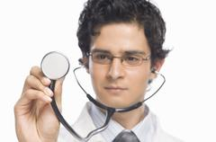 Male doctor holding a stethoscope Stock Photos