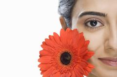 Portrait of a beautiful Indian fashion model with a flower - stock photo