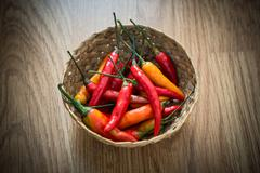 red hot chili peppers in wooden bowl - stock photo