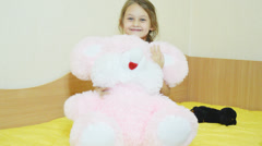 Girl hugging a big soft toy Stock Footage