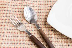 spoon and fork and triangular dishes - stock photo