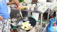 Asian Food Vendor Making Delicious Omelette Stock Footage