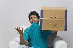 Man holding a cardboard box and looking sad Stock Photos