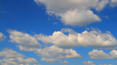 large cumulus clouds against the blue sky - stock footage