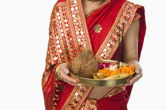 Stock Photo of Woman in traditional Assamese mekhla holding religious offering