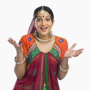 Beautiful woman in lehenga choli shrugging - stock photo
