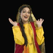 Stock Photo of Portrait of a woman in yellow Punjabi dress with her mouth open