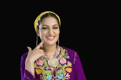 Beautiful woman in Kashmiri dress smiling and touching her cheek Stock Photos