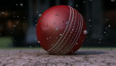 Ultra Motion Cricket Ball Striking Ground With Particles Stock Footage