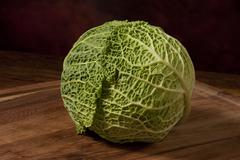 Cabbage close up on the wooden tablet Stock Photos