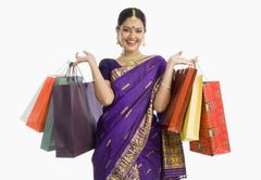 Beautiful Assamese woman holding shopping bags and smiling Stock Photos