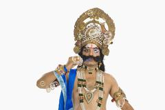 Man dressed-up as Ravana and blowing bubbles Stock Photos