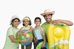Portrait of a happy family enjoying on vacations - stock photo