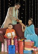Family with shopping bags and gifts on Diwali festival Stock Photos
