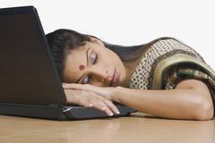 Businesswoman sleeping in an office Stock Photos
